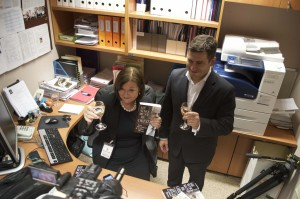 "Kate McClymont and Linton Besser toasting the launch of their book ""He Who must be Obeid"", in Eddie Obeid's former NSW Parliament Office. Two of my photos appeared in this book. (Photo: Kate Doak)"